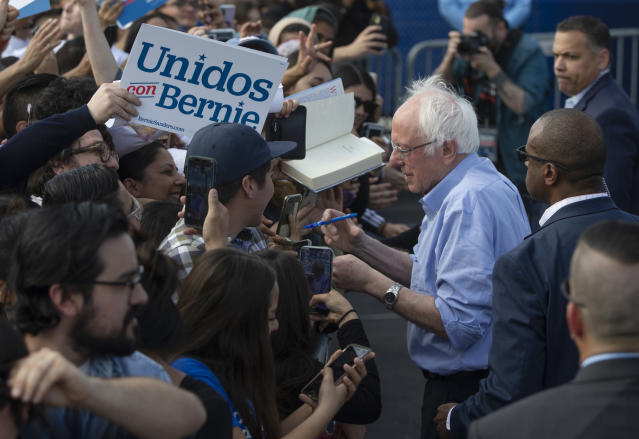 Bernie Sanders with Latino supporters at a campaign event in Santa Ana, Calif. (Damian Dovarganes/AP)