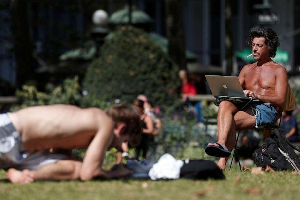 PHOTO: A man works on a computer in the sun at Bryant Park in New York, October 2, 2019. (Shannon Stapleton/Reuters)