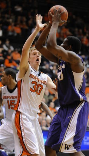 Washington's Shawn Kemp (40) shoots against Oregon State's Olaf Schafenaar (30) during the first half of an NCAA college basketball game in Corvallis, Ore., Wednesday Jan. 23, 2013. (AP Photo/Greg Wahl-Stephens)