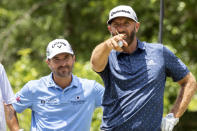 CORRECTS FARAWAY TO FAIRWAY Dustin Johnson points down the ninth fairway before he hits during the first round of the Palmetto Championship golf tournament in Ridgeland, S.C., Thursday, June 10, 2021. (AP Photo/Stephen B. Morton)