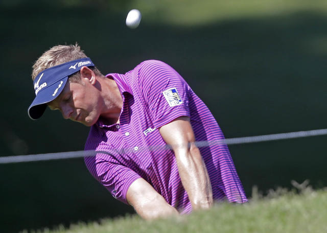 Luke Donald hits onto the 8th green during a practice round for The Players championship golf tournament at TPC Sawgrass in Ponte Vedra Beach, Fla., Wednesday, May 7, 2014. (AP Photo/Gerald Herbert)