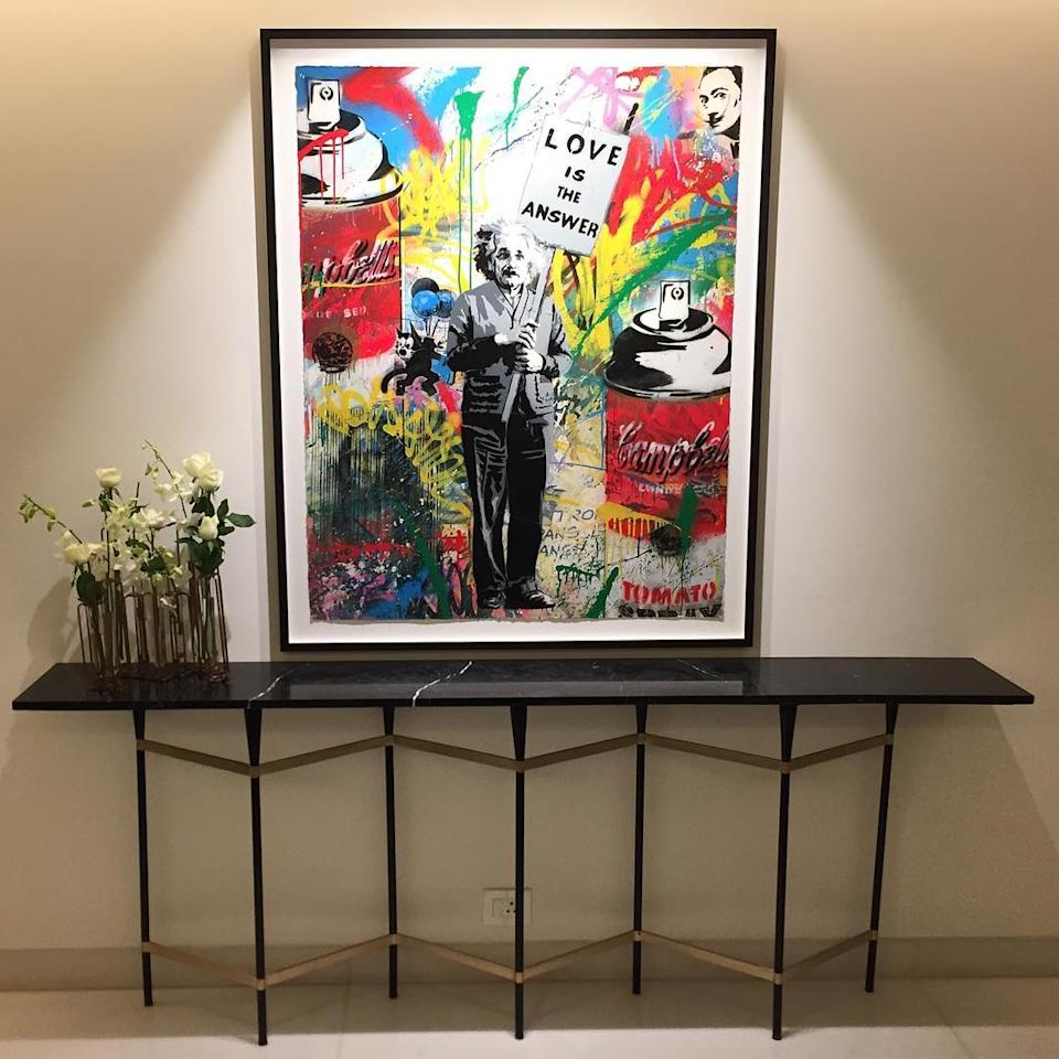 What's a house without some artwork? This colourful palette with Albert Einstein holding a banner saying 'Love is the Answer' adds the right touch of colour to the home decor.