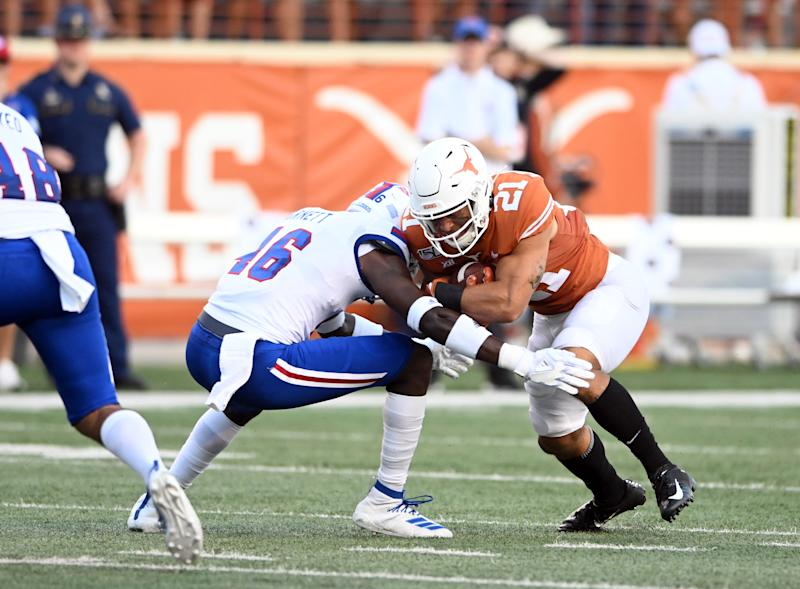 AUSTIN, TX - AUGUST 31: Texas Longhorns RB Jordan Whittington (21) collides with Louisiana Tech Bulldog LB Ezekiel Barnett (46) during game on August 31, 2019, at Darrell K Royal-Texas Memorial Stadium in Austin, Texas. (Photo by John Rivera/Icon Sportswire via Getty Images)
