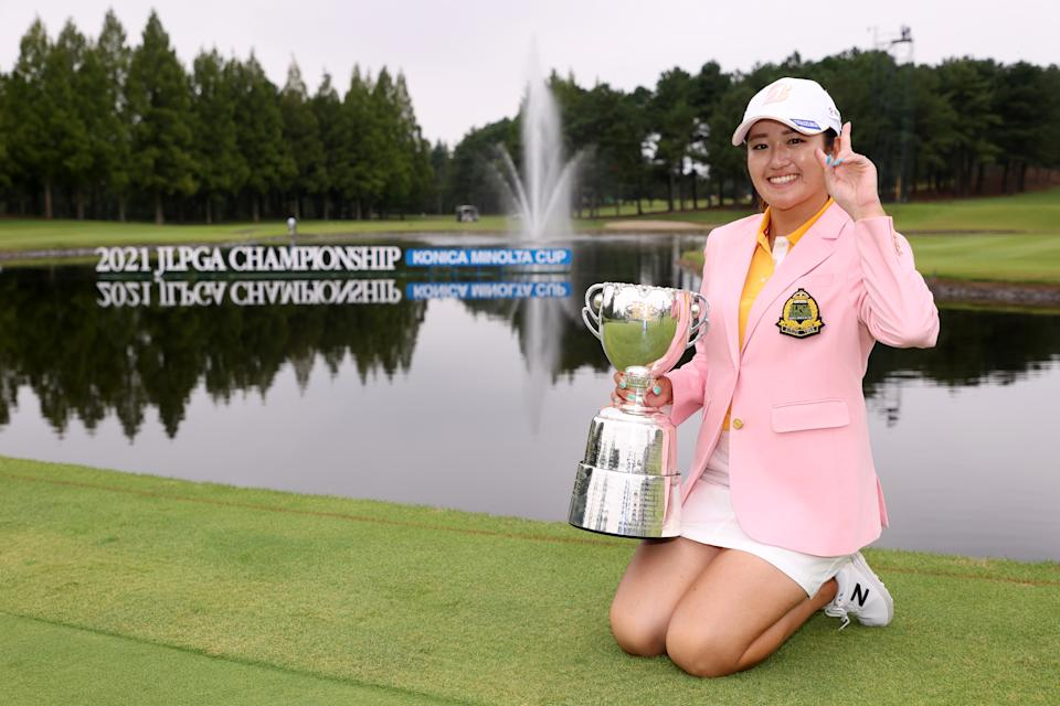 Japanese golfer Mone Inami poses with the trophy after winning the JLPGA Championship Konica Minolta Cup at Shizu Hills Country Club.