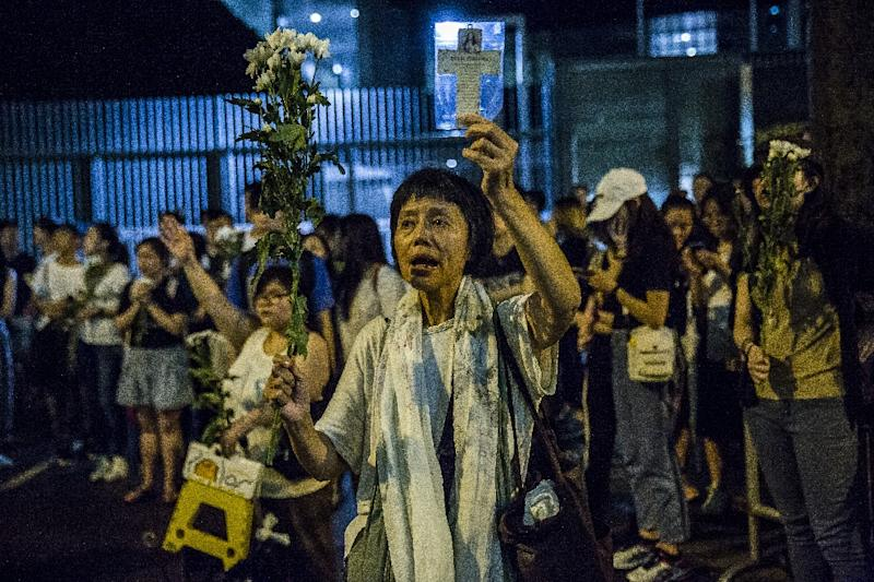 Overnight, a group of around 2,000 protestors held a vigil outside the government offices, with some singing hymns (AFP Photo/ISAAC LAWRENCE)