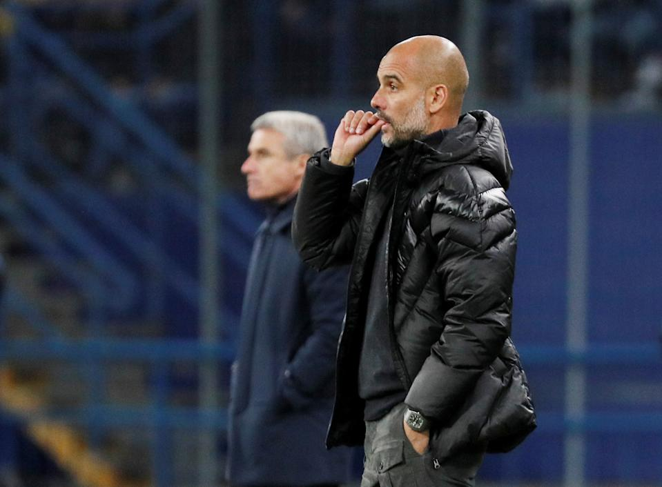 Soccer Football - Champions League - Group C - Shakhtar Donetsk v Manchester City - Metalist Stadium, Kharkiv, Ukraine - September 18, 2019  Manchester City manager Pep Guardiola and Shakhtar Donetsk coach Luis Castro look on  REUTERS/Gleb Garanich