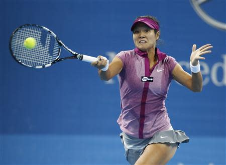 Li Na of China returns a shot against Sabine Lisicki of Germany during their match at the China Open tennis tournament in Beijing