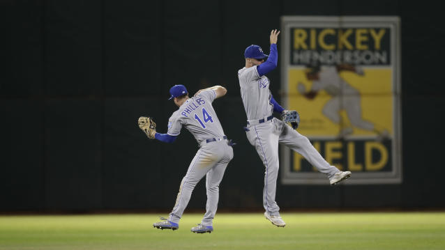 Kansas City Royals' Brett Phillips (14) celebrates the 6-5 win over the Oakland Athletics with Bubba Starling, right, at the end of a baseball game Monday, Sept. 16, 2019, in Oakland, Calif. (AP Photo/Ben Margot)