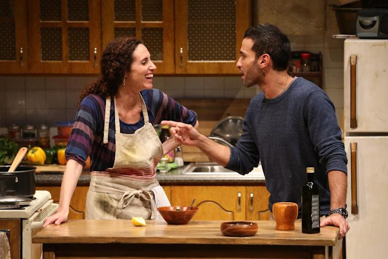 "This theater publicity photo provided by Richard Kornberg & Associates shows Lameece Issaq, left, and Haaz Sleiman in a scene from ""Food and Fadwa,"" in New York.  (AP Photo/Richard Kornberg & Associates, Joan Marcus)"