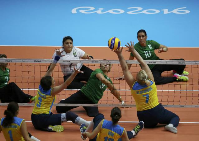 2016 Rio Paralympics - Sitting Volleyball - Women's Bronze Match - Riocentro Pavilion 6 - Rio de Janeiro, Brazil, 17/09/2016. Jani Freitas Batista (BRA) of Brazil and Larysa Klochkova (UKR) of Ukraine in action. REUTERS/Pilar Olivares FOR EDITORIAL USE ONLY. NOT FOR SALE FOR MARKETING OR ADVERTISING CAMPAIGNS.