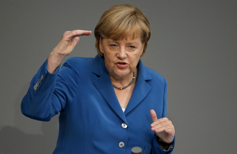German Chancellor Angela Merkel gestures during her speech during a meeting of the German federal parliament, Bundestag, in Berlin, Germany, Tuesday, Sept. 3, 2013. (AP Photo/Michael Sohn)