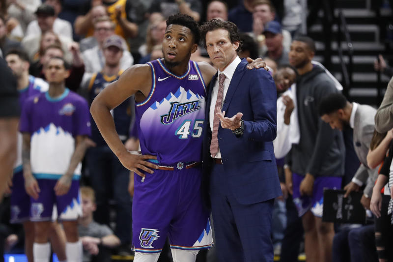 Utah Jazz guard Donovan Mitchell takes a moment with head coach Quin Snyder during the fourth quarter against the Portland Trail Blazers on Thursday, Dec. 26, 2019, in Salt Lake City.