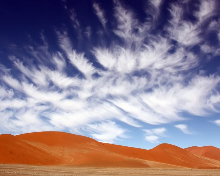 Kulala Wilderness Reserve, Sossusvlei region, Namib Desert, Namibia -On a sunrise outing in this land of ochre-colored towering dunes, the wind suddenly feather the clouds in this deep blue sky. © World Wildlife Fund/Lester Reed