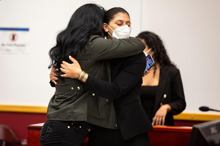 Des Moines Register Reporter Andrea Sahouri hugs her mom Muna Tareh-Sahouri after being found not guilty at the conclusion of her trial, on Wednesday, March 10, 2021, at the Drake University Legal Clinic, in Des Moines, Iowa.