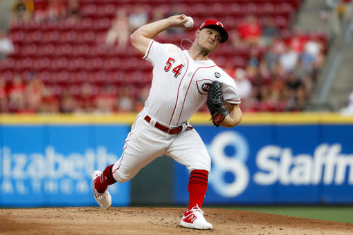 Cincinnati Reds starting pitcher Sonny Gray throws in the first inning of a baseball game against the Pittsburgh Pirates, Monday, July 29, 2019, in Cincinnati. (AP Photo/John Minchillo)