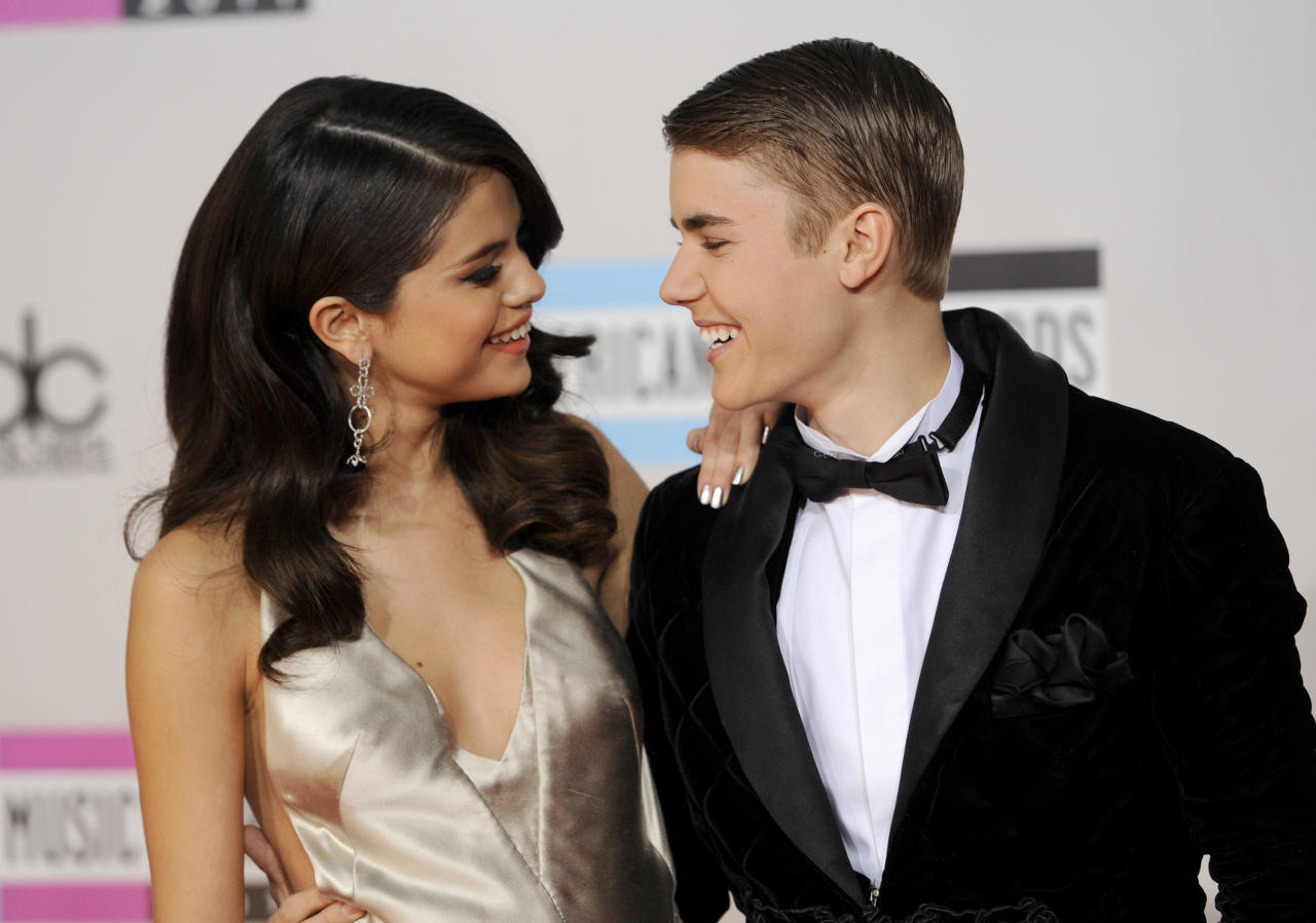 <p> FILE - In this Nov. 20, 2011, file photo, Selena Gomez, left, and Justin Bieber arrive at the 39th Annual American Music Awards in Los Angeles. Hackers briefly took control of Gomez's Instagram account on Aug. 28, 2017, and posted nude photos of Bieber. (AP Photo/Chris Pizzello, File) </p>