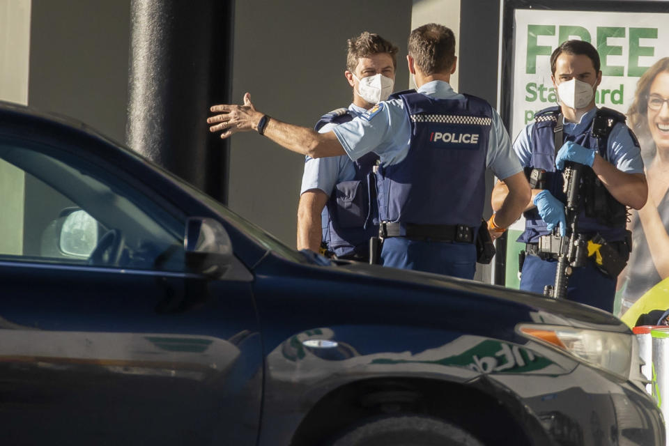 Police stand outside a supermarket in Auckland, New Zealand, Saturday, Sept. 4, 2021. New Zealand authorities say they shot and killed a violent extremist, Friday Sept. 3, after he entered a supermarket and stabbed and injured six shoppers. Prime Minister Jacinda Ardern described Friday's incident as a terror attack. (AP Photo/Brett Phibbs)