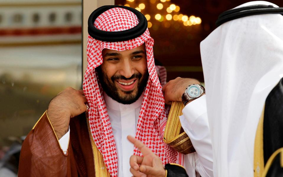 In this May 14, 2012 file photo, Prince Mohammed bin Salman speaks with a Saudi prince in Riyadh, Saudi Arabia. The disappearance of Saudi journalist and contributor to The Washington Post Jamal Khashoggi on Oct. 2, 2018 raised questions about businesses connected to the regime - Hassan Ammar /AP