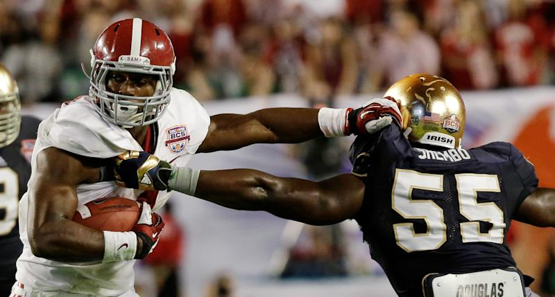 Alabama's T.J. Yeldon tries to get past Notre Dame's Prince Shembo (55) during the first half of the BCS National Championship college football game Monday, Jan. 7, 2013, in Miami. (AP Photo/David J. Phillip)