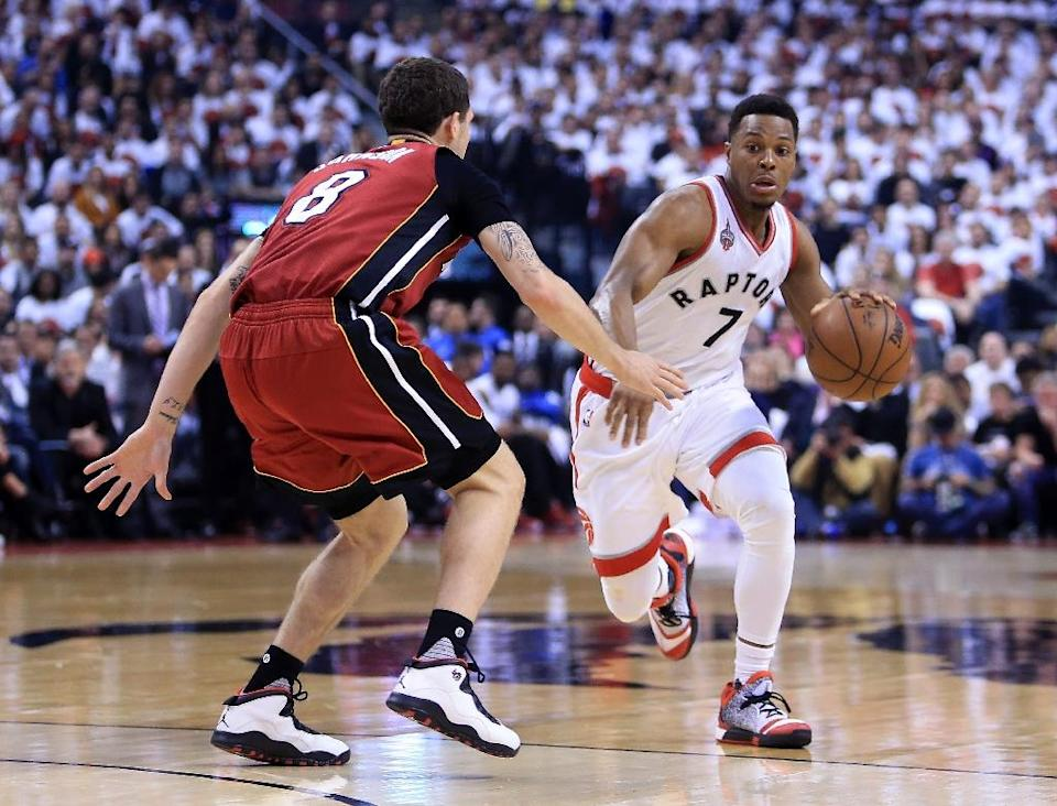 Kyle Lowry (R) scored 35 points as Toronto completed a 116-89 win over the Miami Heat to seal a 4-3 series victory (AFP Photo/Vaughn Ridley)