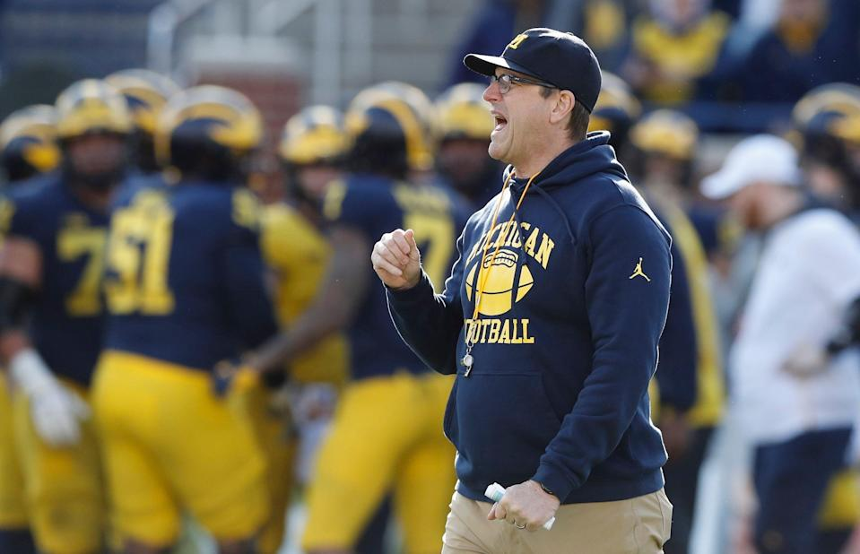 Michigan head coach Jim Harbaugh watches the team's annual spring NCAA college football game, Saturday, April 13, 2019, in Ann Arbor, Mich. (AP Photo/Carlos Osorio)