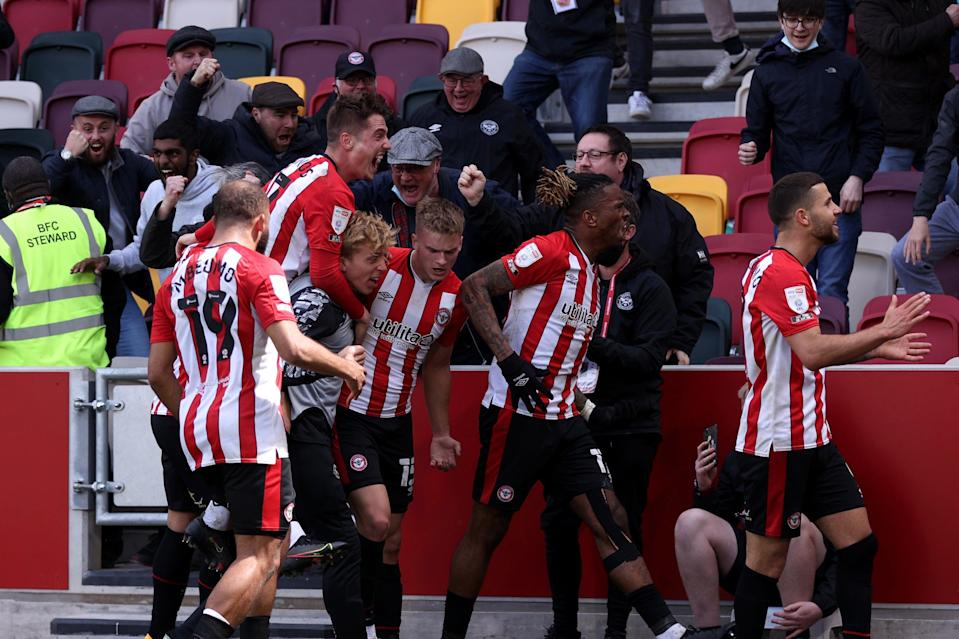 <p>Brentford celebrate with fans after their decisive third goal against Bournemouth</p> (Getty Images)