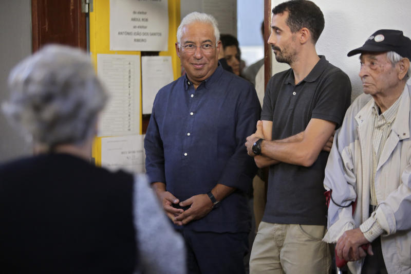 Portuguese Prime Minister and Socialist Party leader Antonio Costa waits in line to cast his ballot at a poll station in Lisbon Sunday, Oct. 6, 2019. Portugal is holding a general election Sunday in which voters will choose members of the next Portuguese parliament. (AP Photo/Armando Franca)
