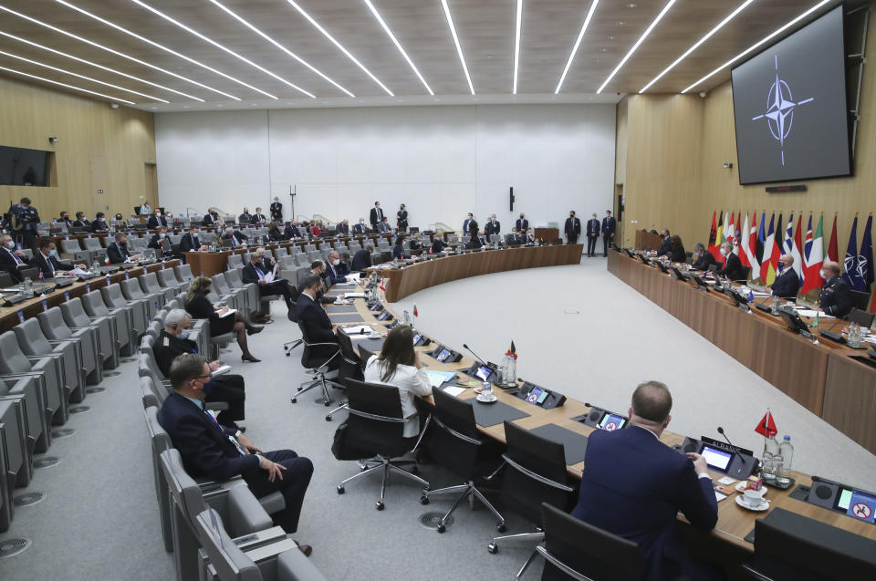 Foreign Ministers and their teams gather during a NATO foreign ministers meeting at NATO headquarters in Brussels, Tuesday, March 23, 2021. (Yves Herman, Pool via AP)