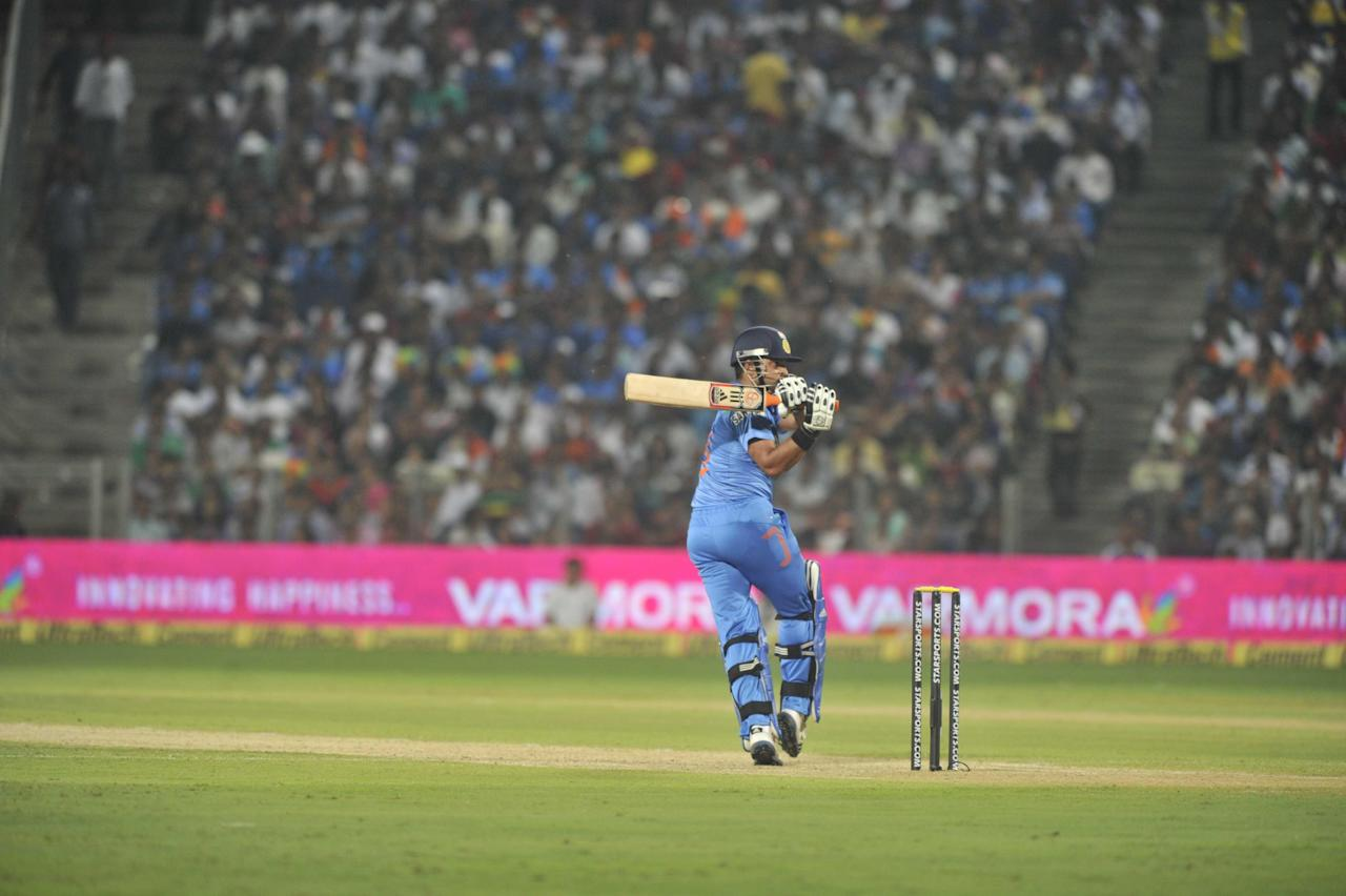 Suresh Raina in action during the 1st ODI between India and Australia at Maharashtra Cricket Association Stadium, Pune on Oct. 13, 2013. (Photo: IANS)