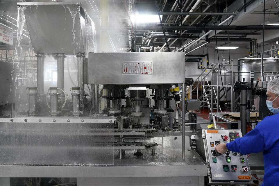 Foreman Dave Garthe runs boiling water through and over machinery in preparation for Hanan Products kosher-for-passover production run, Thursday, Jan. 7, 2021, in Hicksville, N.Y. At Hanan Products, which since 1946 has made primarily whipped toppings, icings and dessert fillings for the bakery industry, cleaning and production for kosher-for-Passover products begin long before the weeklong holiday that this year starts in late March. (AP Photo/Seth Wenig)