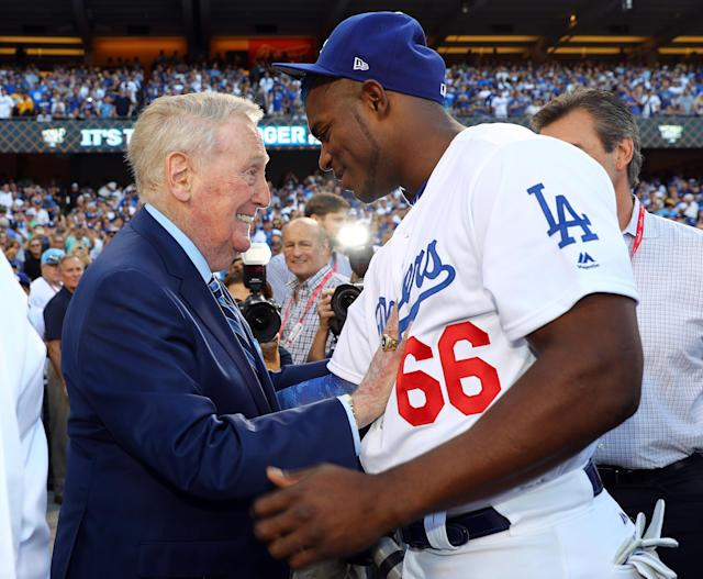 <p>Hall of Fame broadcaster Vin Scully talks to Yasiel Puig #66 of the Los Angeles Dodgers before Game 2 of the 2017 World Series against the Houston Astros at Dodger Stadium on Wednesday, October 25, 2017 in Los Angeles, California. (Photo by Alex Trautwig/MLB Photos via Getty Images) *** Local Caption *** Vin Scully, Yasiel Puig </p>