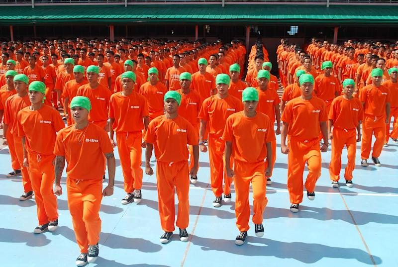 "In this photo taken March, 2010 and released by Portfolio Films Wednesday, April 3, 2013, inmates of Cebu Provincial Detention and Rehabilitation Center perform during the taping of the movie ""Dance of the Steel Bars"" inside the jail compound in Cebu province, central Philippines. The Filipino inmates whose choreographed ""Thriller"" dance has attracted 52 million YouTube hits since 2007 are getting their own stories told in a movie. (AP Photo/Portfolio Films) NO SALES"