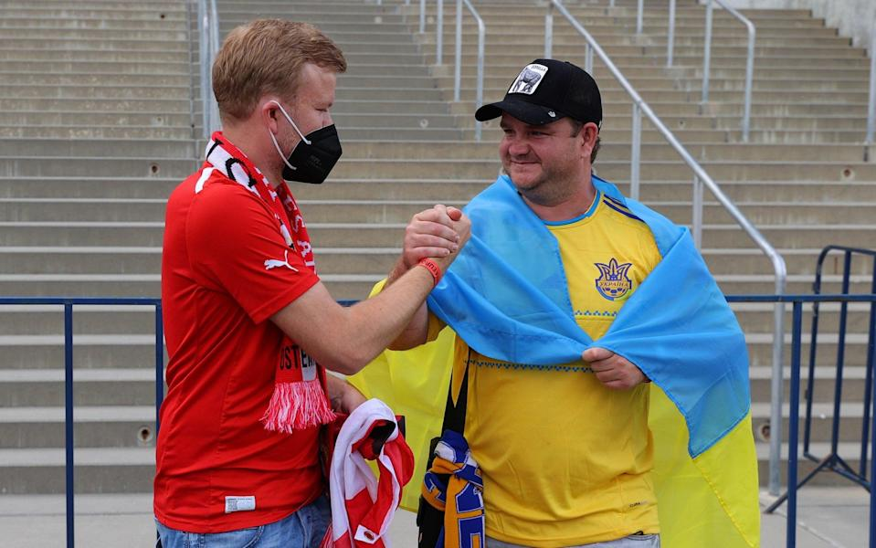 Ukraine and Austria fans outside the stadium in Bucharest before the match - REUTERS/Marko Djurica