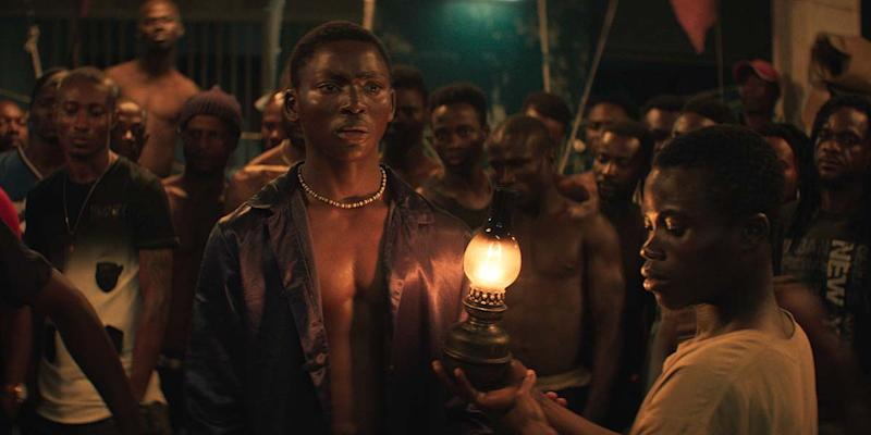 """Koné Bakary (center) stars as a jailed pickpocket forced into being a storyteller in a prison run by its inmates in the drama """"Night of the Kings."""""""