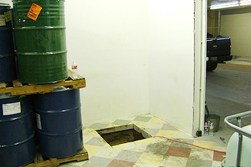 In this undated photo provided by the United States Drug Enforcement Administration, shows floor shaft entrance from a storage room that was a 240-yard, a complete and fully operational drug smuggling tunnel that ran from a small business in Arizona to an ice plant on the Mexico side of the border, Thursday, July 12, 2012, in San Luis, Ariz.(AP Photo/Drug Enforcement Administration)