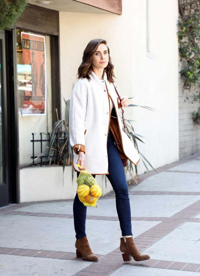 <p>Alison Brie wears Old Navy's long Sherpa faux suede-lined coat while grocery shopping in Los Angeles on Oct. 15, 2018. (Photo: Sara Jaye Weiss/Startraks) </p>