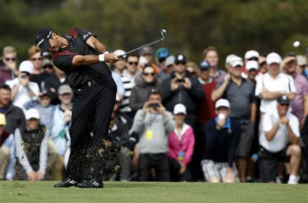 Day plays his approach shot to the 18th green on his way to winning the World Cup of Golf in Melbourne