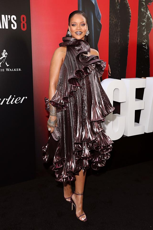 <p>Rihanna looked stunning at the world premiere wearing a purple Givenchy Fall 2018 pleated edge dress with ruffles. Such a statement dress. Source: Getty </p>