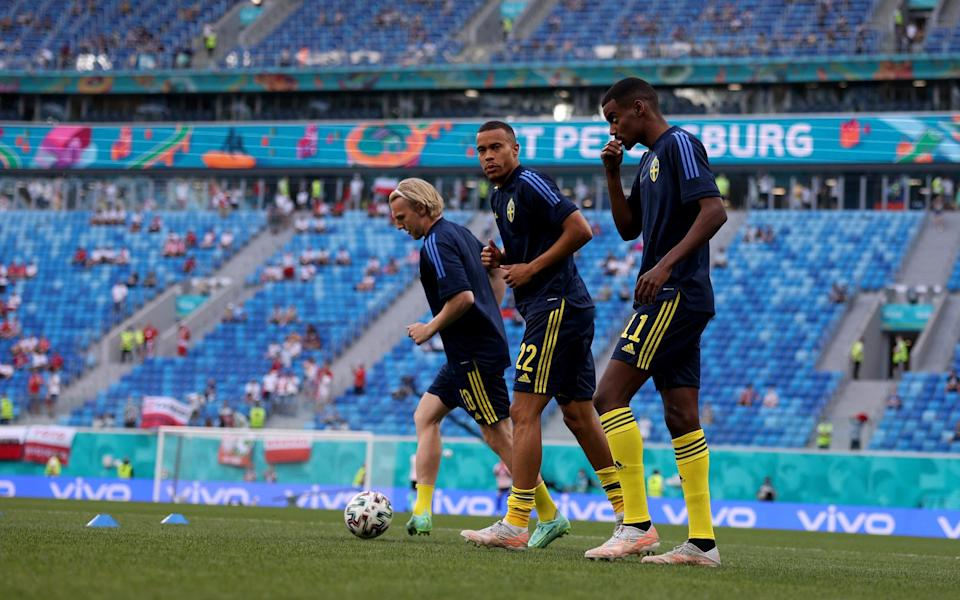 Emil Forsberg, Robin Quaison and Alexander Isak (left to right) warm up together - GETTY IMAGES