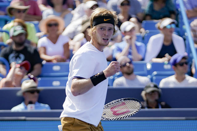Andrey Rublev, of Russia, reacts during a match against Roger Federer, of Switzerland, during the quarterfinals of the Western & Southern Open tennis tournament, Thursday, Aug. 15, 2019, in Mason, Ohio. (AP Photo/John Minchillo)