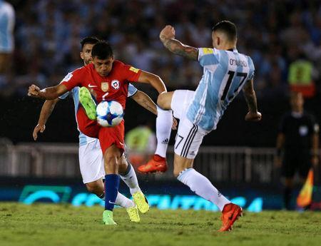 Football Soccer - Argentina v Chile - World Cup 2018 Qualifiers - Antonio Liberti Stadium, Buenos Aires, Argentina - 23/3/17 - Argentina's Nicolas Otamendi (R) and Chile's Alexis Sanchez compete for the ball. REUTERS/Marcos Brindicci