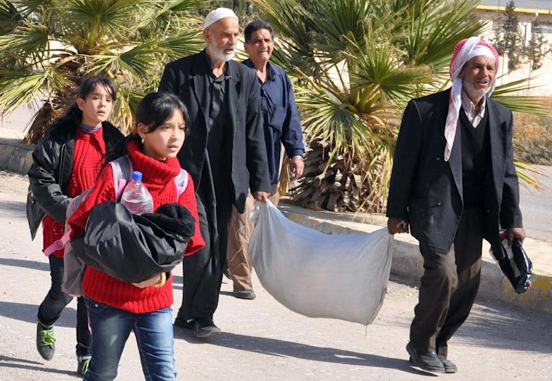 Residents of Moadamiyet al-Sham evacuated the neighbourhood in 2003 after hundreds died in chemical strikes (AFP Photo/)