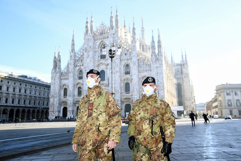 Image: Military officers stand outside Duomo cathedral in Milan
