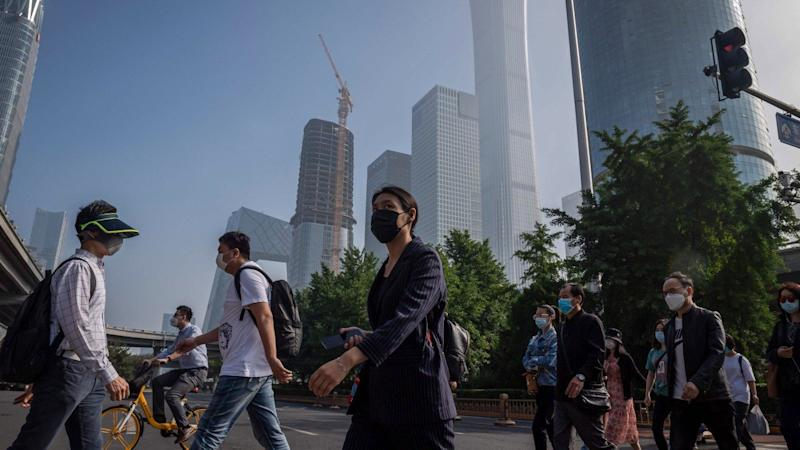 Meagre gains for Hong Kong, mainland stocks, as investors weigh upbeat China economic data against US market dip, Covid-19 surge