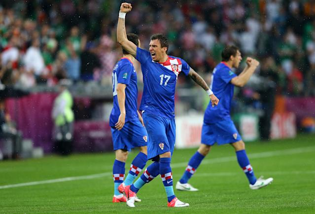 POZNAN, POLAND - JUNE 10: Mario Mandzukic of Croatia celebrates scoring their first goal during the UEFA EURO 2012 group C between Ireland and Croatia at The Municipal Stadium on June 10, 2012 in Poznan, Poland. (Photo by Christof Koepsel/Getty Images)