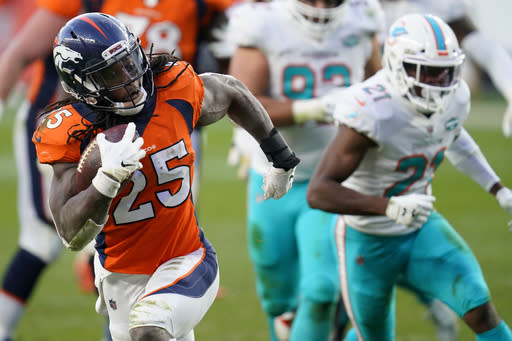 Denver Broncos running back Melvin Gordon (25) runs for his second touchdown of the game against the Miami Dolphins during the second half of an NFL football game, Sunday, Nov. 22, 2020, in Denver. (AP Photo/David Zalubowski)