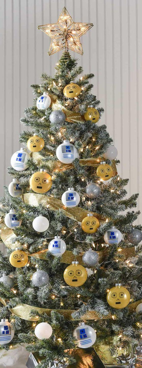 "<p>Turn your tree into an out-of-this-world <em>Star Wars</em>–themed masterpiece by creating these C-3PO and R2-D2 ornaments.</p><p>Get the tutorial at <a href=""https://diycandy.com/star-wars-christmas-tree/"" rel=""nofollow noopener"" target=""_blank"" data-ylk=""slk:DIY Candy"" class=""link rapid-noclick-resp"">DIY Candy</a>.</p><p><a class=""link rapid-noclick-resp"" href=""https://go.redirectingat.com?id=74968X1596630&url=https%3A%2F%2Fwww.etsy.com%2Flisting%2F747644450%2Fcircle-shaped-sublimation-blanks%3Fgpla%3D1%26gao%3D1%26gclid%3DCjwKCAjwps75BRAcEiwAEiACMRSRpK0GZOdnCp9rDB3jXngMqozugeuHtpmvxVaOOGg8WbXw6XhW-hoCjqoQAvD_BwE&sref=https%3A%2F%2Fwww.housebeautiful.com%2Fentertaining%2Fholidays-celebrations%2Ftips%2Fg505%2Fchristmas-tree-decoration-ideas-pictures-1208%2F"" rel=""nofollow noopener"" target=""_blank"" data-ylk=""slk:SHOP ORNAMENTS"">SHOP ORNAMENTS</a> <strong><em>Blank Ornament, $2</em></strong></p>"