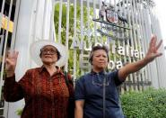 """FILE PHOTO: Anti-coup protesters flash the three-finger sign from the movie """"The Hunger Games"""" during a protest outside the Australian embassy in Bangkok"""