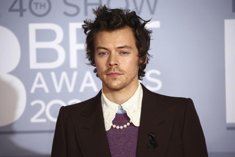 Harry Styles poses for photographers upon arrival at the Brit Awards 2020 in London, Tuesday, Feb. 18, 2020. (Photo by Joel C Ryan/Invision/AP)