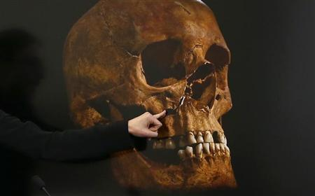File photogrpah shows project Osteologist Jo Appleby pointing out damage to a skull during a news conference in Leicester